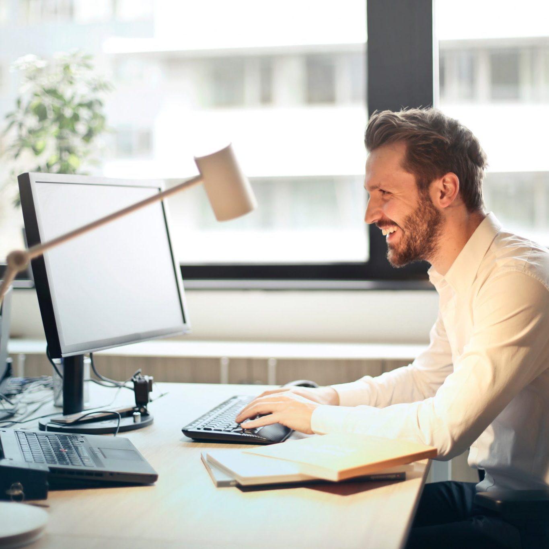man-in-white-dress-shirt-sitting-on-black-rolling-chair-840996